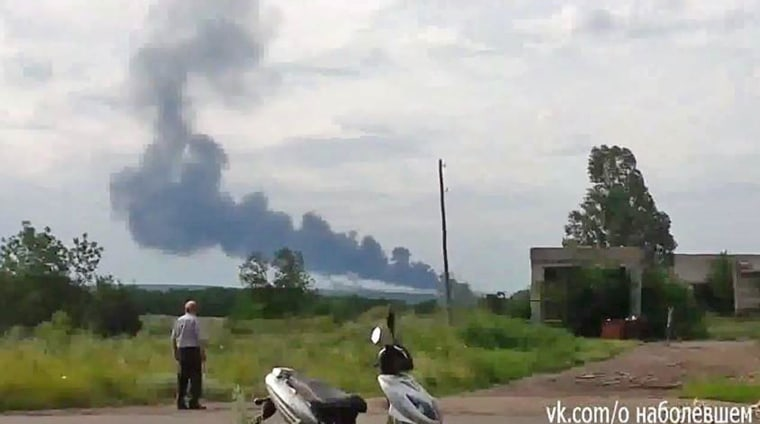 A plume of smoke rises from the reported site of a plane crash in Ukraine