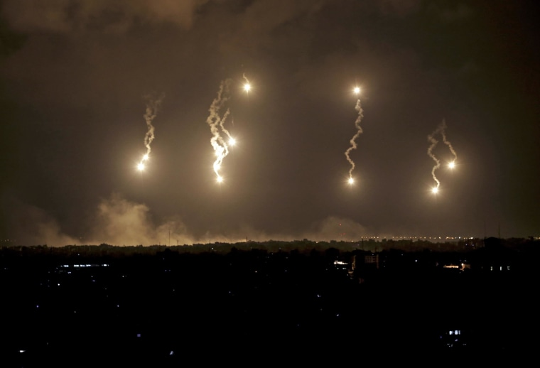 Image: Israeli flares light up the night sky in the northern Gaza Strip early Saturday.