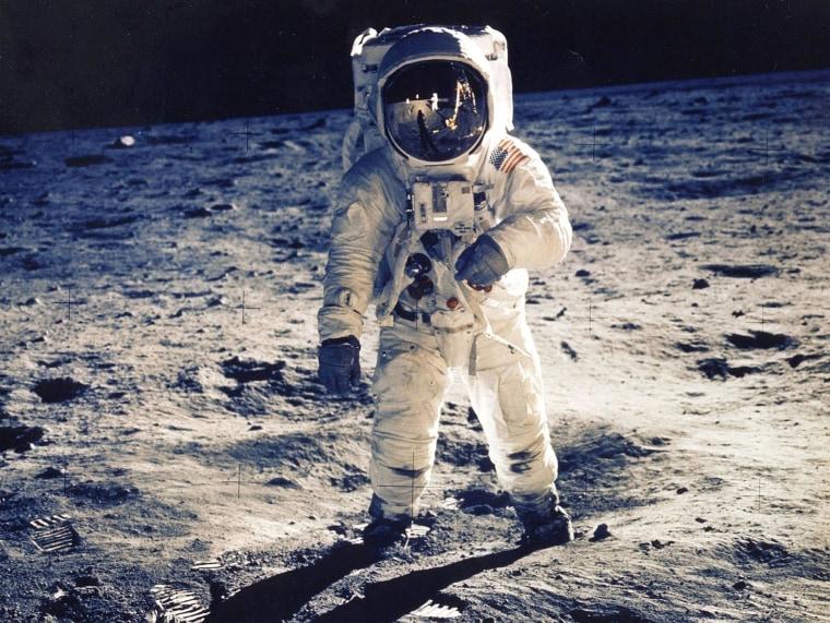 Image: Astronaut Edwin E. Aldrin Jr., Lunar Module Pilot, is photographed walking near the Lunar Module during the Apollo 11 Extravehicular Activity.