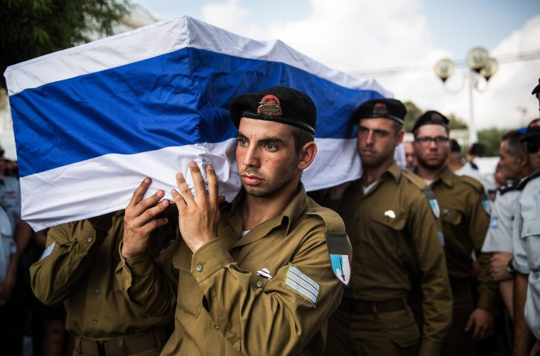 Image: The casket carrying Israeli Sergeant Adar Barsano is carried to a burial plot in a cemetary during his funeral on July 20 in Nahariya, Israel.