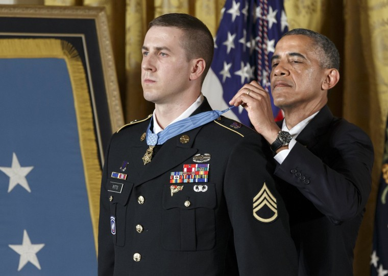 President Barack Obama bestows the Medal of Honor, the nation's highest decoration for battlefield valor, to Ryan M. Pitts, 28, of Nashua, NH, a former Army staff sergeant who fought off enemy fighters during one of the bloodiest battles of the Afghanistan war despite his own critical injuries, in the East Room of the White House in Washington, Monday, July 21, 2014.