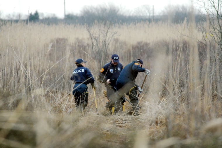 Image: Crime Scene investigators use metal detectors to search a marsh for the remains of Shannan Gilbert on Dec. 12, 2011 in Oak Beach, NY