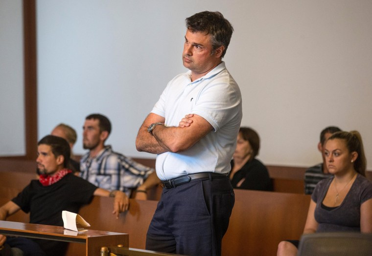 Image: Jet Blue pilot John Manwaring stands as he is arraigned in Boston Municipal Court on a heroin possession charge on July 21, in Boston.