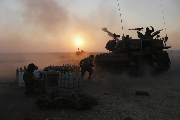 Image: An Israeli mobile artillery unit fires towards the Gaza Strip