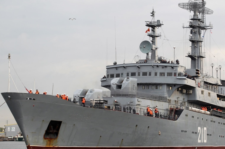 Image: Russian sailors are seen on deck of Russian navy frigate Smolny as it arrives at the Saint-Nazaire STX Les Chantiers de l'Atlantique shipyard