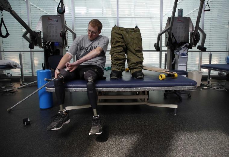 Image: Sgt. Matt Krumwiede prepares to put on prosthetic legs at Brooke Army Medical Center in San Antonio