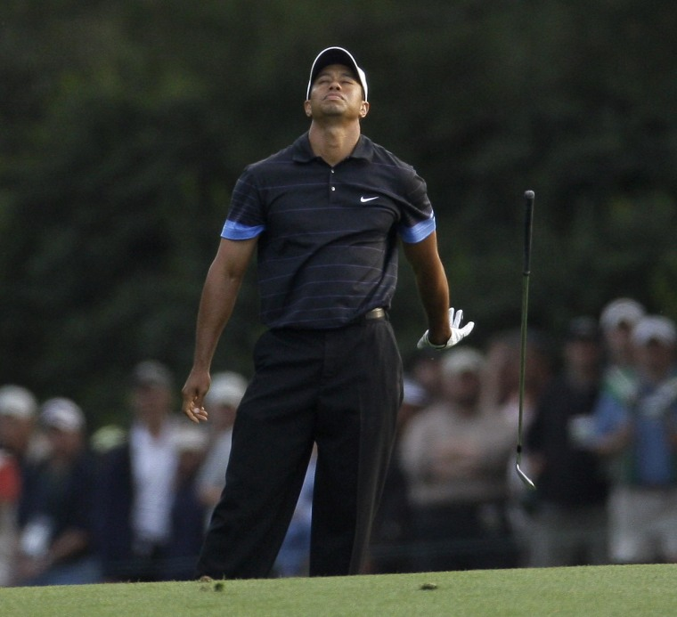 Tiger Woods getting out of a bunker. Golf's popularity has declined with Woods' fall from grace and loss of form.