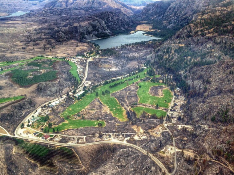 An aerial cellphone photo shows a largely burned landscape near Alta Lake, Pateros, Wash. The massive Carlton Complex Fire has been burning through Washington state.