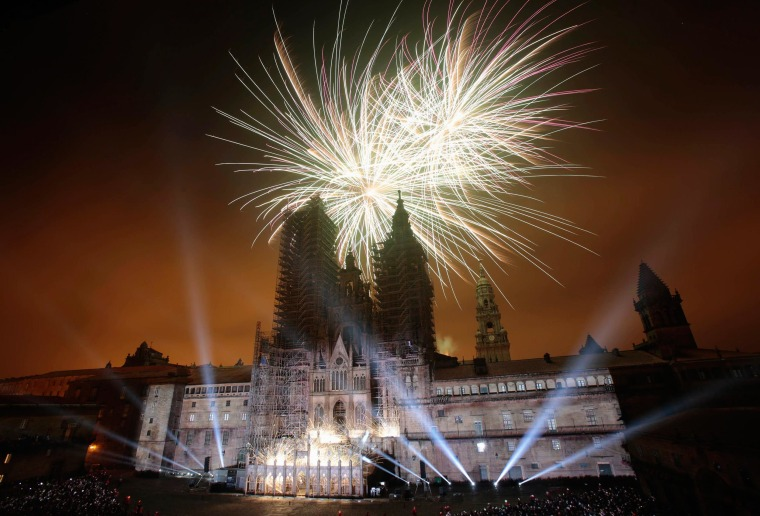 Image: Fireworks explode over an ancient cathedral during celebrations for St. James' day in Santiago de Compostela, northwestern Spain