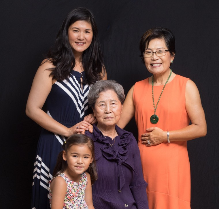 Four generations of women (l-r): Connie Chung Joe, daughter Lindy Nari Joe, grandmother Keum Bong Kim, and Dr. Young Kim Susan Chung. In this photo, Dr. Chung replicates an archived photo by mimicking similar facial expressions and hand gestures in place of her father.