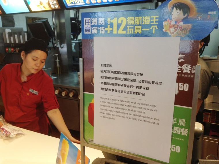 Image: Signs apologizing for the meat shortages were on display at a branch of McDonald's in Beijing Monday.
