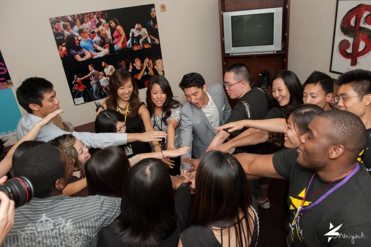 The Kollaboration New York staff huddles before the 2013 showcase.