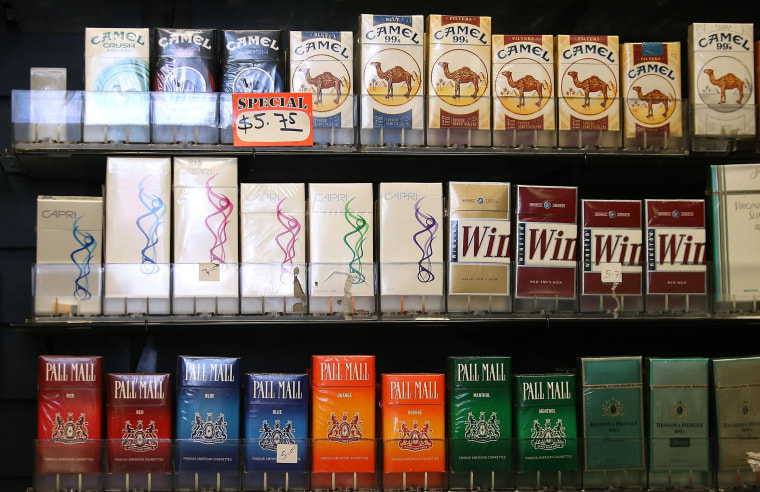 Image: Cigarette brands manufactured by Reynolds Amercian are displayed at a tobacco shop on July 11 in San Francisco, Calif.
