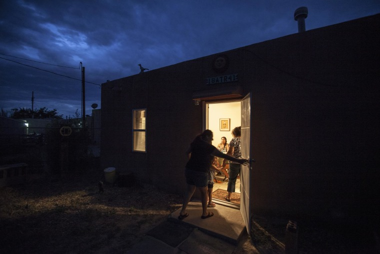 Image: The exterior of Danielle Lucero's traditional pueblo family home where she hosted a feast for Columbia University mentors.
