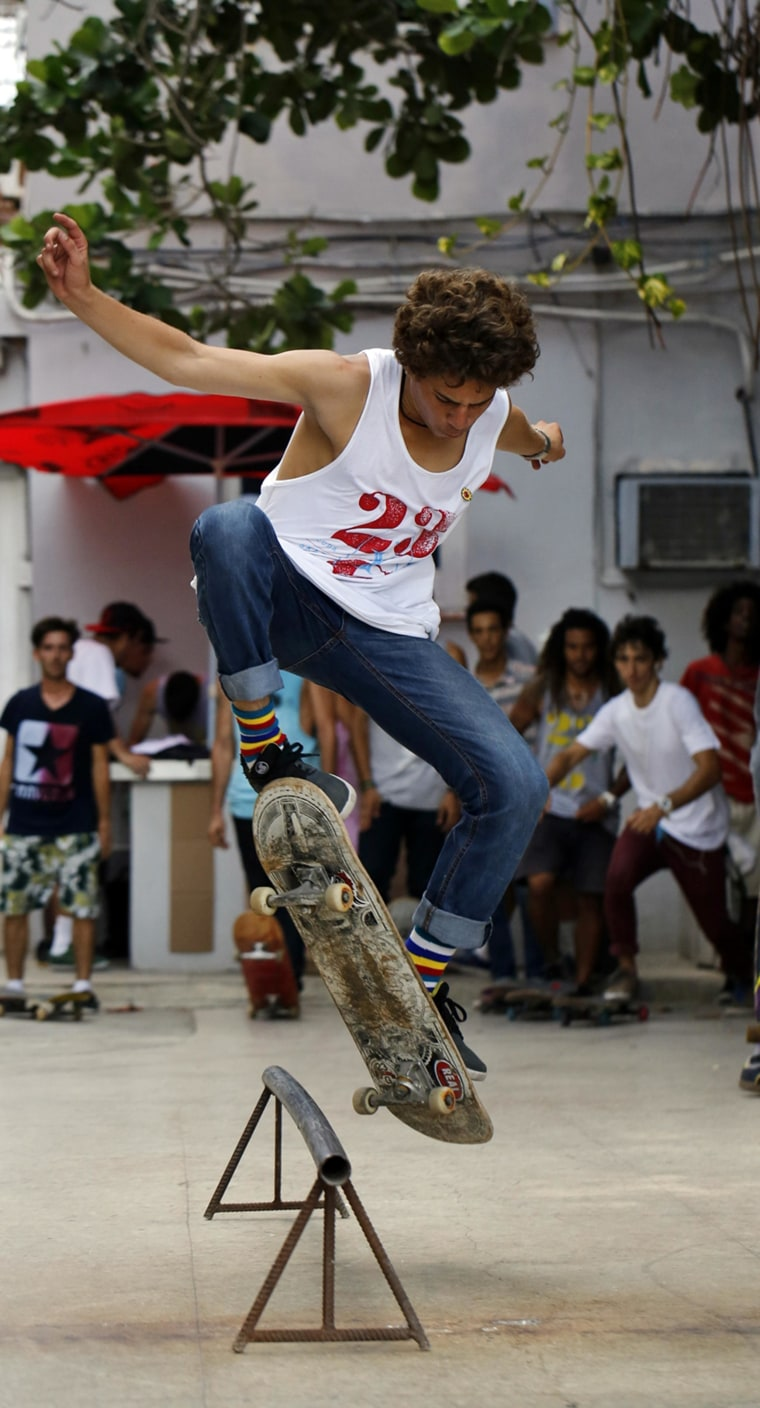"""Image: A Cuban skateboarder, part of the """"G y 23"""" generation as the group is known"""