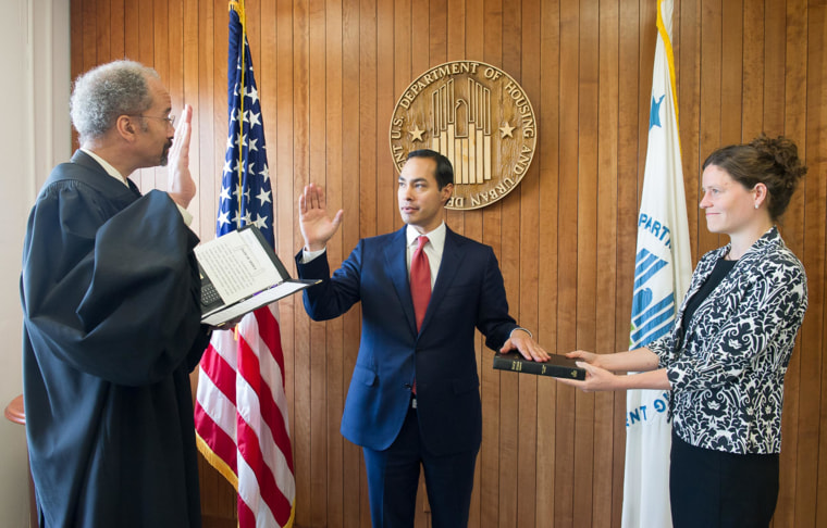 Image: Julian Castro, center, is sworn in as Secretary for the U.S. Department of Housing and Urban Development, in Washington, on July 28.