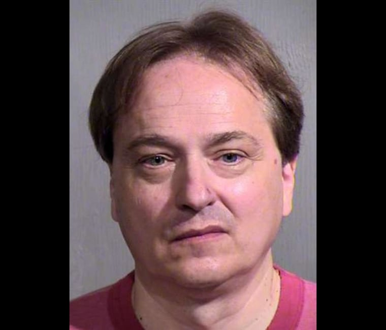 Peter Steinmetz was arrested on suspicion of pointing a rifle toward a woman and her 17-year-old daughter inside a busy Phoenix airport terminal.