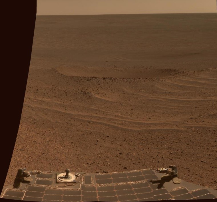 This true-color view from NASA's Opportunity rover shows Lunokhod 2 Crater, a newly named Martian feature that lies south of Solander Point on the west rim of Endeavour Crater. Lunokhod 2 Crater is approximately 20 feet (6 meters) in diameter. The view was obtained was obtained on April 24. Part of the rover is visible at bottom.