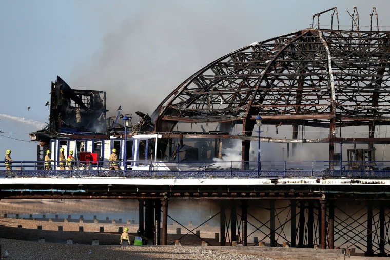 Image: The remains of Eastbourne Pier after a fire broke out in the arcade building in Eastbourne, England.