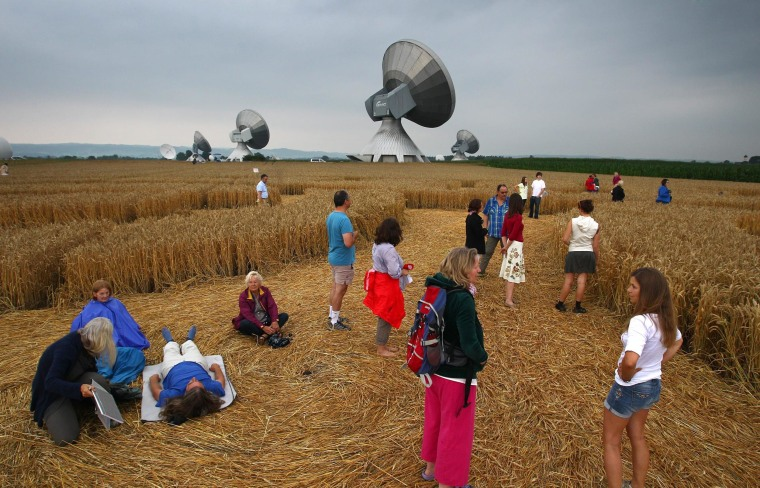 Visitors wandering through a field where crop circles have been found near the satellite earth station in Raisting, Germany.