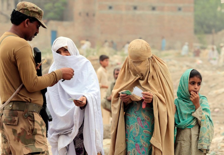 Internally displaced women beg a soldier to allow them to enter a food distribution centre set up in a sports stadium in Bannu, in northwest Pakistan July 25. Thousands of women displaced by fighting in Pakistan are struggling to get food and other aid because they lack identity cards and conservative Muslim elders have forbidden them from going to distribution centres.