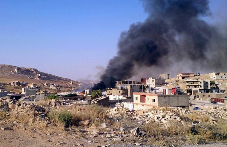 Image: Smoke billows from Arsal, a Sunni Muslim town near the Syrian border in eastern Lebanon