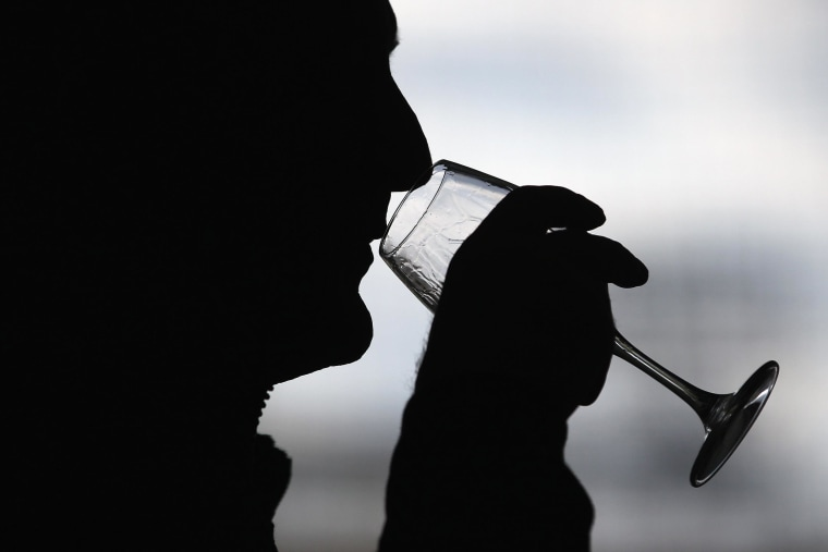 Image: A person drinking wine