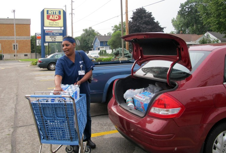 Image: Sharon Green loads bottled water into her car in Toledo