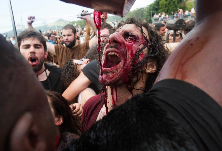 Image: A man dressed up as a Viking drinks local red wine during the annual Viking festival of Catoira in north-western Spain