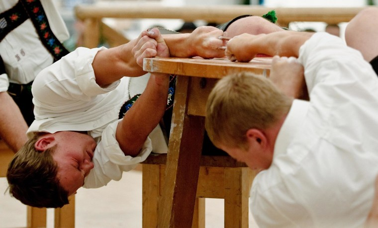 """Image: Participants compete during the German """"finger wrestling"""" championships"""