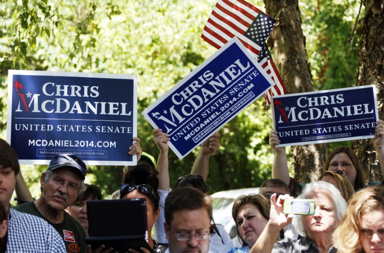 Supporters of state Sen. Chris McDaniel of Ellisville, Miss., who sought to unseat the incumbent U.S. Sen. Thad Cochran in the Republican primary, wave their signs and flags during a news conference by his attorneys and advisers in Jackson, Miss., Wednesday, July 16, 2014. Lawyers for tea party candidate McDaniel said that they intend, in the next 10 days, to file a challenge of McDaniel's loss to six-term Sen. Thad Cochran in the Mississippi Republican primary. Certified results of the June 24 runoff show Cochran won by 7,667 votes.