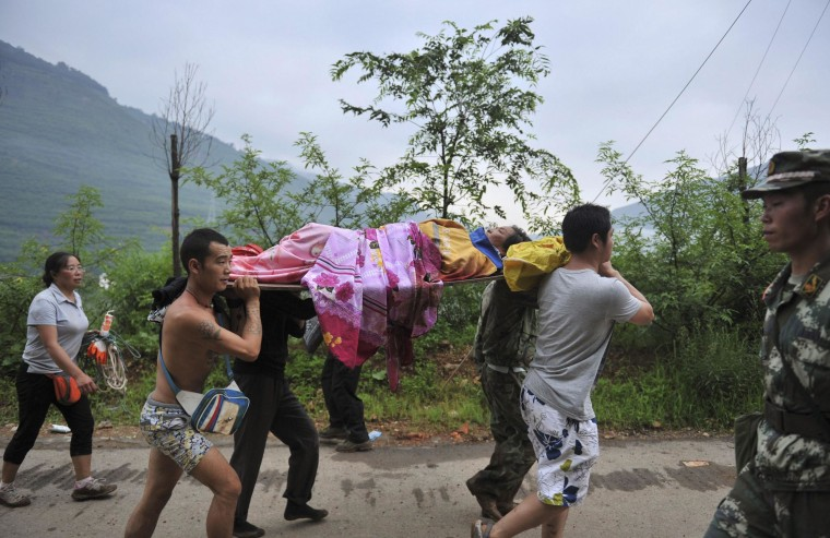 Image: Injured person is evacuated after a magnitude 6.3 earthquake hit Longtoushan town, Ludian county, Zhaotong, Yunnan province