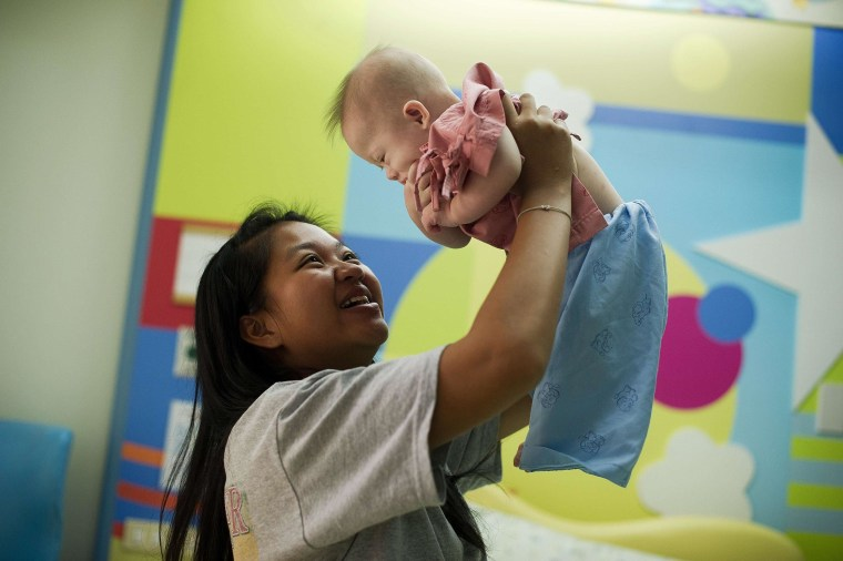 Image: Thai surrogate mother Pattaramon Chanbua with her baby Gammy, born with Down Syndrome, at the Samitivej hospital