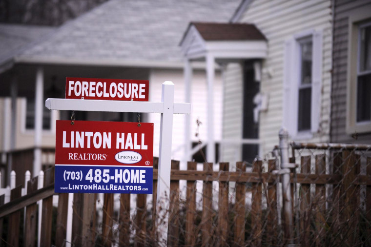 Image: A foreclosure sign is posted in the front of a house in Alexandria, Va. on Dec. 17 2008.