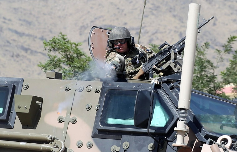 A NATO soldier opens fire near the main gate of Camp Qargha, west of Kabul, Afghanistan, on Tuesday.