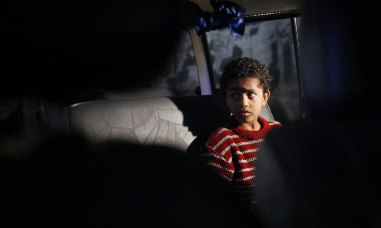 A homeless Egyptian boy sits in a van belonging to the Kafr El Sisi Center for Children At Risk in the Giza neighborhood of Cairo in 2007.