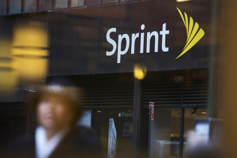 Image: File picture of people walking past a Sprint store in New York