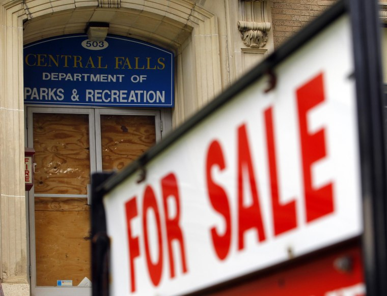 """A """"For Sale"""" sign is seen outside the boarded up entrance to the Central Falls Department of Parks and Recreation in Central Falls, Rhode Island August 1, 2011.  Central Falls, one of a handful of U.S. cities and counties facing fiscal collapse in the wake of the economic recession, filed for a rare Chapter 9 bankruptcy on Monday.    REUTERS/Brian Snyder    (UNITED STATES - Tags: BUSINESS)"""