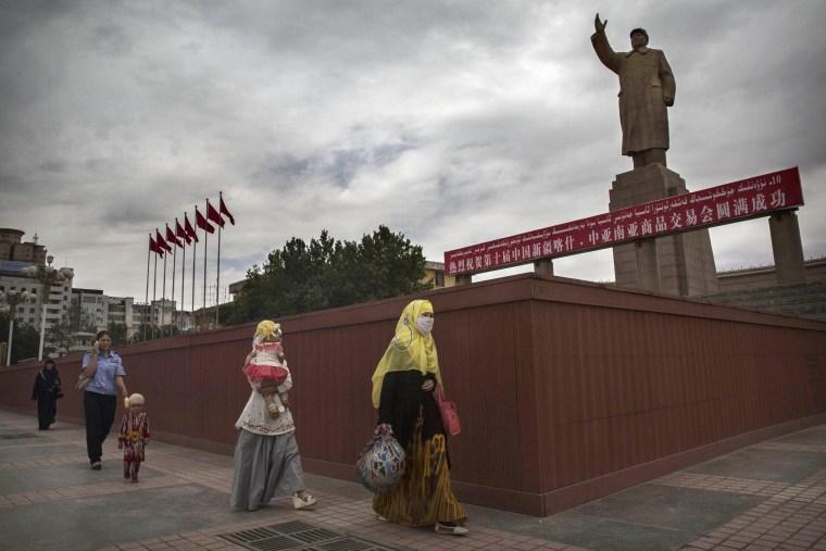 Image: A veiled Muslim Uighur woman in Kashgar in 2014