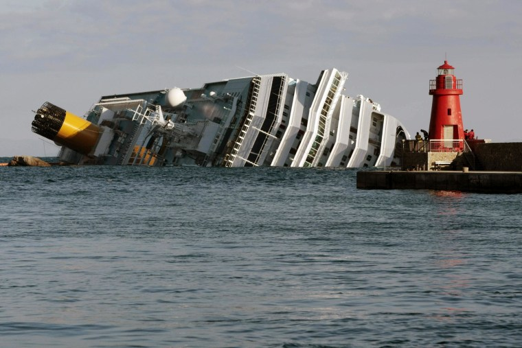 The cruise ship Costa Concordia leans on its side Tuesday, Jan. 17, 2012, after running aground on the tiny Tuscan island of Giglio, Italy.