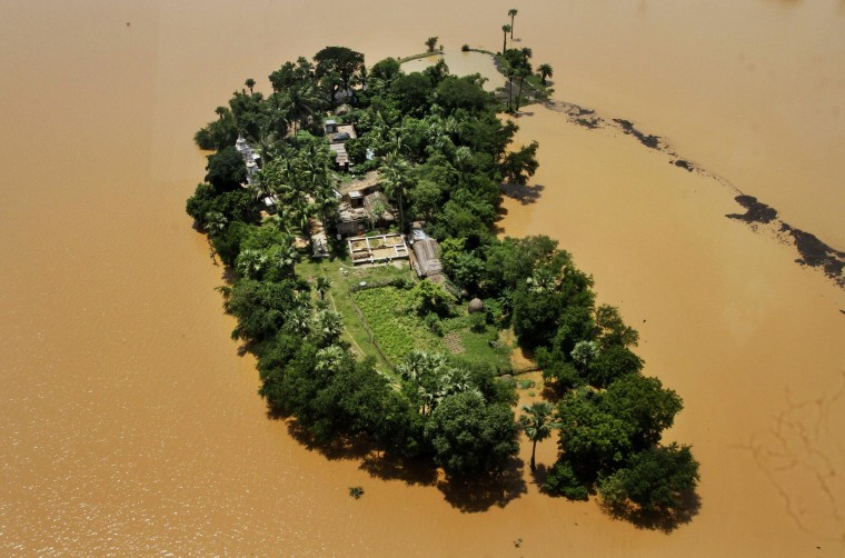Image: An aerial view shows houses cut-off by monsoon floods in Kendrapara district of eastern Orissa state, India.