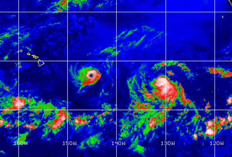 Hurricane Isell (C) nearing the Hawaiian islands on August 6, 2014. At 1200 GMT, Iselle was about 745 miles (1,200 kilometers) east of Hilo, Hawaii, and some 945 miles east-southeast of Honolulu.  Hawaii on Wednesday braced for a walloping by a rare duo of storms headed for the vacation paradise, with local residents rushing to stock up on water and flashlights. Hurricane Iselle, while predicted to weaken to a tropical storm, was expected to bring strong wind, heavy rains and possibly damaging swells to the archipelago's main islands by Thursday. At right Hurricane Julio can be seen, which is also moving toward the islands.