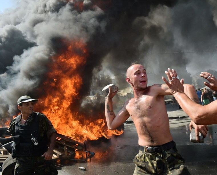 Image: Maidan self-defense activists clash with fighters from the Kiev-1 volunteer battalion on Independence Square in Kiev