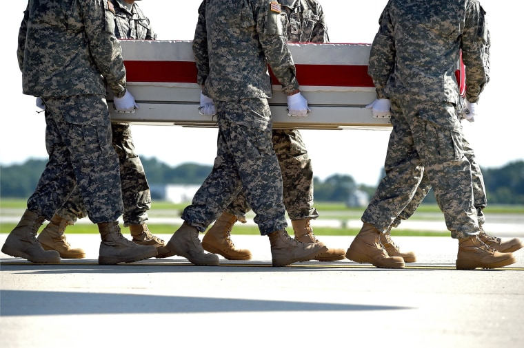 U.S. Army soldiers carry the flag-draped transfer case containing the remains of U.S. Army Maj. Gen. Harold J. Greene during a dignified transfer at Dover Air Force Base on August 7 in Dover, Delaware. According to reports, Greene, who was from Schenectady, New York, assigned to the Combined Security Transition Command, was killed after his unit was attacked in Afghanistan.