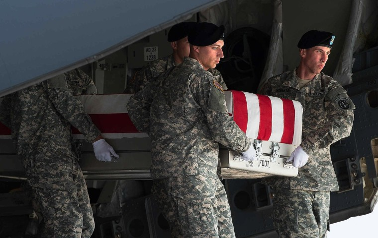 Image: A U.S. Army detail carries a transfer case with the body of Major General Harold Greene during a dignified transfer at the Dover Air Force Base in Dover