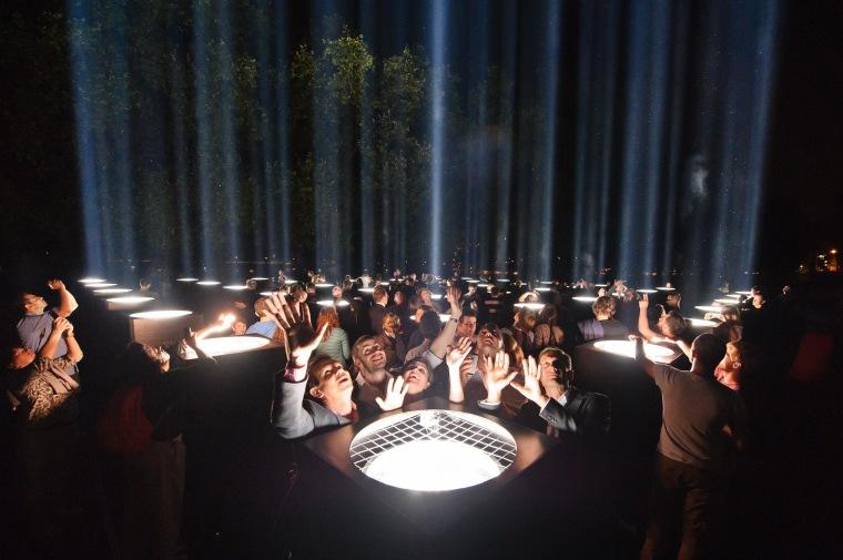 Image: People enjoy an installation by artist Ryoji Ikeda