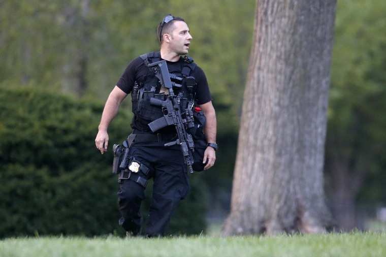 Image: A member of the U.S. Secret Service Emergency Response Team (ERT) stands watch on the North Lawn at the White House in Washington,