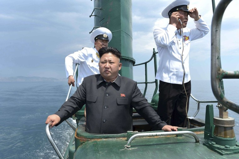 Image: North Korean leader Kim Jong Un stands on the conning tower of a submarine during his inspection of the KPA Naval Unit 167