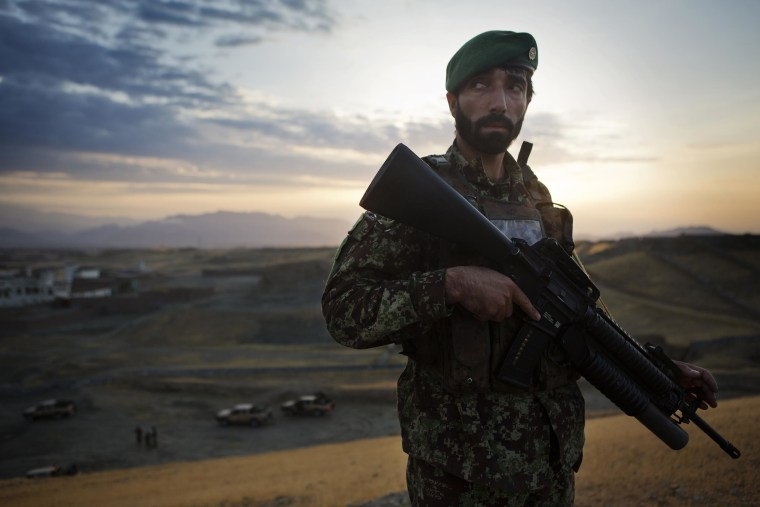 Image: An Afghan National Army soldier of the 4th Brigade, 201st Corps participates in a large clearing operation in the district of Pachir Wa Agam, Nangarhar Province, Afghanistan
