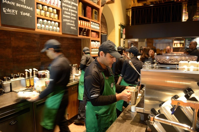 Image: Staff work behind the counter of India's first newly-inaugurated Starbucks outlet in Mumbai on Oct. 19, 2012.